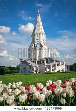 Ascension church in Museum-Reserve Kolomenskoye with tulips in the foreground,  Moscow, Russia