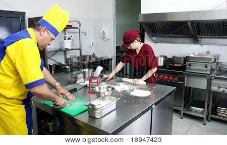 Two cooks preparing delicious pastry