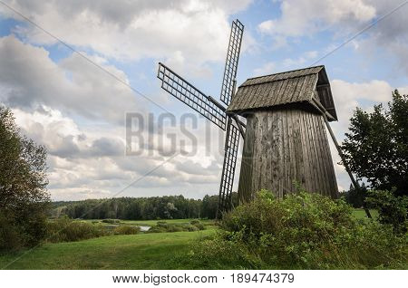 Country landscape with old windmill in Mikhailovskoe village Museum-reserve of A.S. Pushkin Pskov region Russia