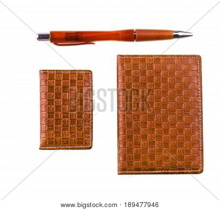 Leather notebook business card holder and ballpoint pen on white background