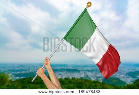 Young man's hands proudly waving the Italy national flag in the sky, part 3D rendering