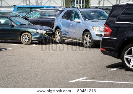 Car accident in the parking lot. Inattention behind the wheel concept
