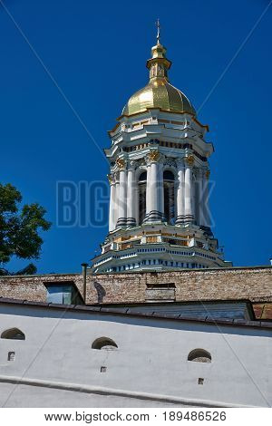 Early morning. The Great Bell Tower of Lavra and a fragment of the fortress wall in the Kiev Pechersk Lavra of the Orthodox Church
