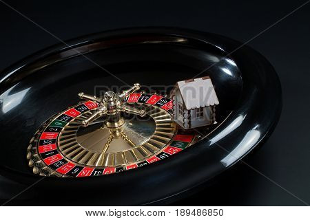 Toy wooden house on the roulette wheel