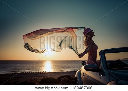 Silhouette Of Young Woman At The Beach