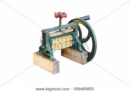 Old Grinder squid machine for Sugar cane and Dry squid made from cast iron and brass on white background with clipping path