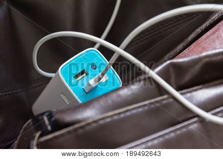 USB Battery Bank on Leather Bag Commute Technology Charging Business Wire Cable