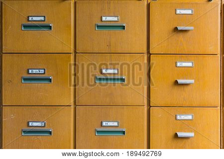 Wooden File Cabinet Straight On Geometric Pattern Squares Empty Labels Doors Closed Old Vintage Brow