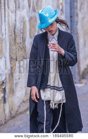JERUSALEM - MARCH 13 : Ultra Orthodox drunk boys during Purim in Mea Shearim Jerusalem on March 13 2017 Purim is a Jewish holiday celebrates the salvation of the jews from genocide in ancient Persia