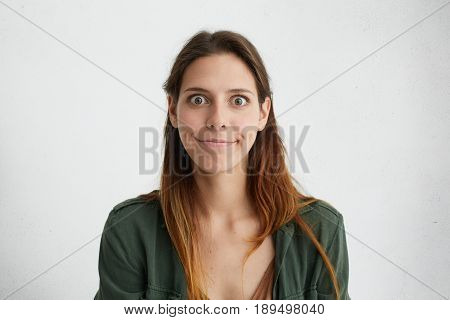 Portrait Of Amazed Surprised Woman With Straight Long Hair And Big Dark Eyes Having Compressed Lips