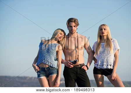 Man With Camera In Hand Taking Photo Of Women, Girls