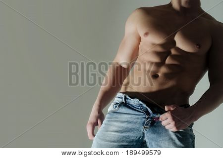 Torso Of Muscular Man In Jeans