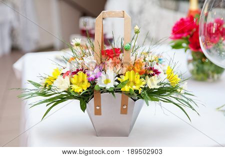 Bouquet of chrysanthemums and irises arrangement gift