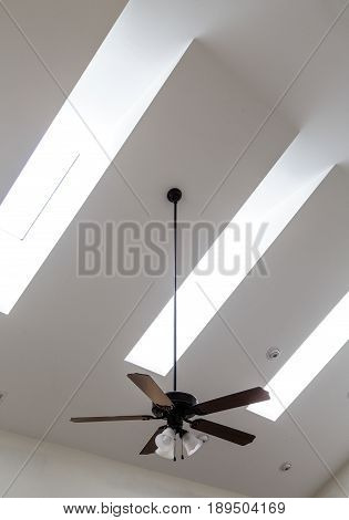 Ceiling Fan and Skylights on White Ceiling