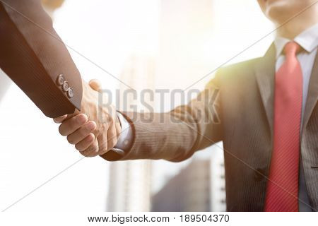 Businessmen making handshake - greeting dealing merger and acquisition concepts