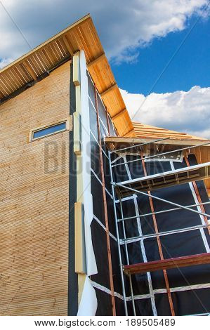 Polystyrene insulation of wood buildings. Eco-friendly building insulation