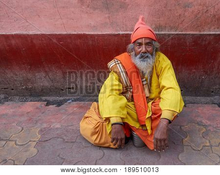 An elderly Indian man in winter in sacred city of Vrindavan