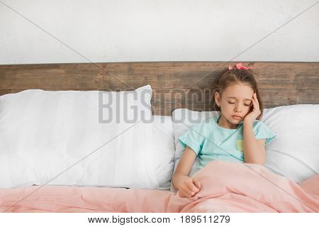 Young teenager girl alone at home childhood sick feeling unwell