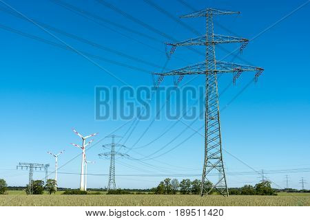 Transmission lines with some wind wheels seen in Germany