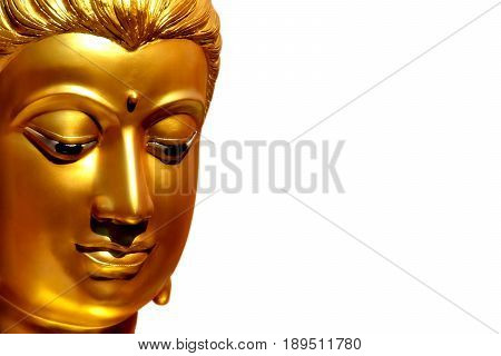 The golden face of the old Buddha statue isolated with copy space and clipping path.