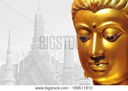 The golden face of the old Buddha statue with temple backdrop in Thailand. clipping path.