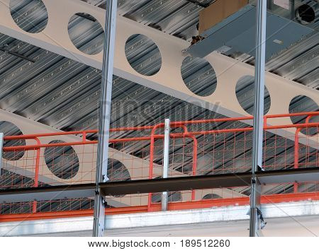 building development construction site with beams fencing girders and scaffold