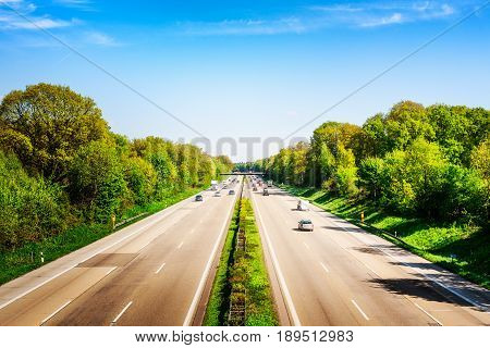 Highway traffic with cars and trucks on sunny spring day Germany