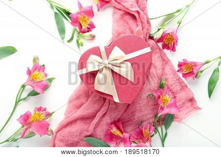 Pink Alstroemeria Flowers With Gauze Fabric And Gift Box On A White Background