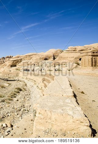 Petra Jordan - 9 March 2017: Tourists walking near Djinn Blocks - ancient tombs Petra Jordan 9 March 2017