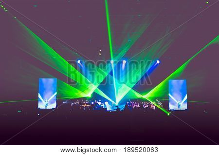 Blurred Background : Bokeh Lighting At Stage In Concert With Audience ,music Showbiz Concept,pale Vi