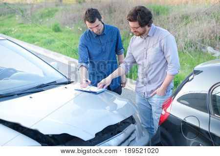 Two Man Finding A Friendly Agreement After  Car Accident