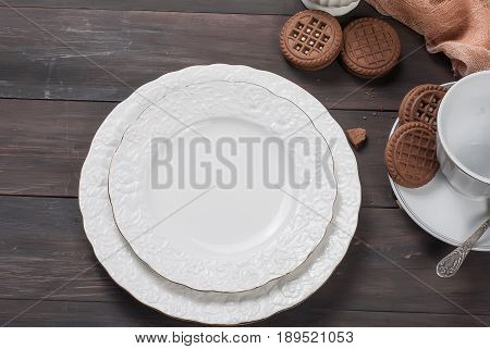 Empty Plates And Cup On Wooden Table