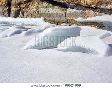 Frozen water covered with snow in Lake Baikal Russia
