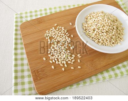 Bowl of Sweet mochi rice on wooden board