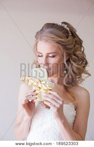 the bride at a wedding in the wedding dress eating white chocolate