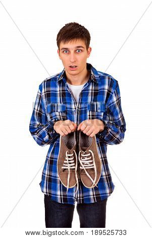Surprised Young Man with Sneakers Isolated on the White Background