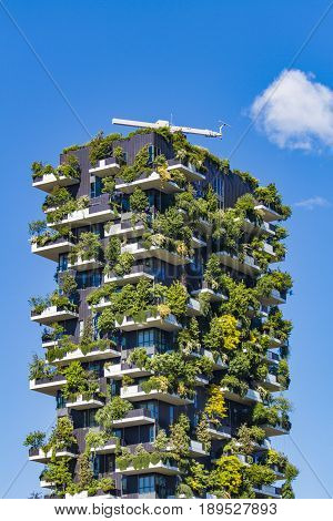 MILAN ITALY-APRIL 28 2017: Detail of the Bosco Verticale in Milan Italy. It is a pair of residential towers in the Porta Nuova district of Milan that host more than 900 trees.