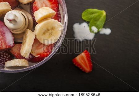 strawberry banana fruit in a blender ready to blend