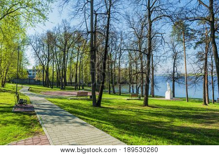NIZHNY TAGIL RUSSIA - MAY 14 2016: Summer Park on the shore of the pond
