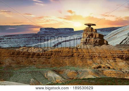 Famous rock Mexican Hat near village of Mexican Hat near Monument Valley, Utah, USA at sunset