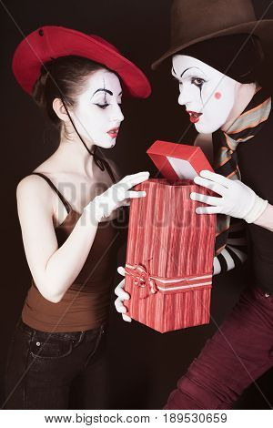 A Man Mime Gives A Gift To A Woman