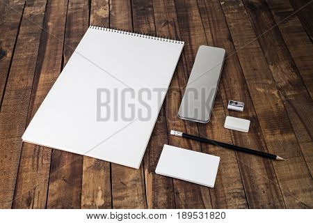 Photo of blank stationery set on wood table background. Blank template with plenty of copy space for designers. Responsive design mockup.
