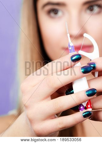 Woman Holding Small Toothbrush And Dental Floss