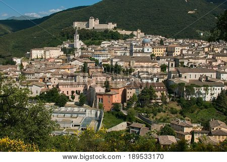 Panoramic view of Spoleto in the summer season with the gorses