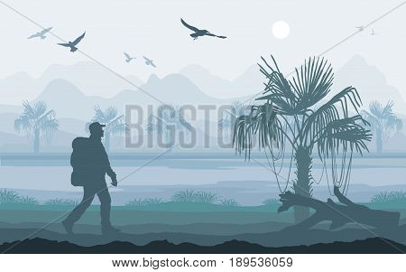 Hiker enjoying tropical landscape with mountains, forest and sky. Mountaineering and Traveling. Mountain Peaks.