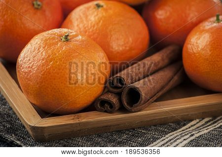 Ripe mandarine citrus . tangerine mandarine orange on wooden background. Mandarins in plate
