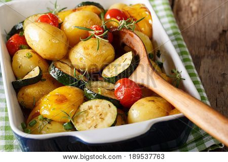 Spicy Potatoes Baked With Zucchini, Bell Pepper And Tomatoes Close-up. Horizontal