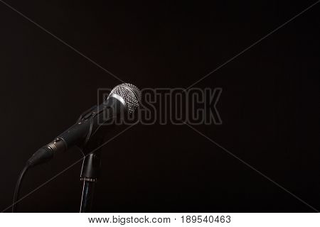 Microphone on empty black background