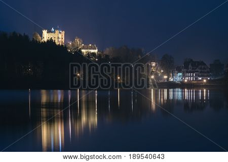 Hohenschwangau near Fussen in Bavaria Germany. Evening on the Alpsee lake overlooking the castle Hohenschwangau.