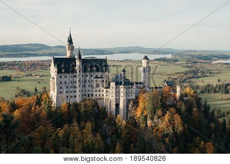 Beautiful aerial view of Neuschwanstein castle in autumn season. Palace situated in Bavaria Germany. Neuschwanstein castle one of the most popular palace and travel destination in Europe and world.